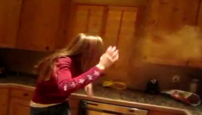 Girl violently expels powder after trying to take the 'Cinnamon Challenge'
