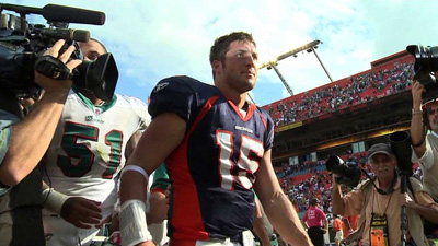 Tim Tebow leaves the field in Miami