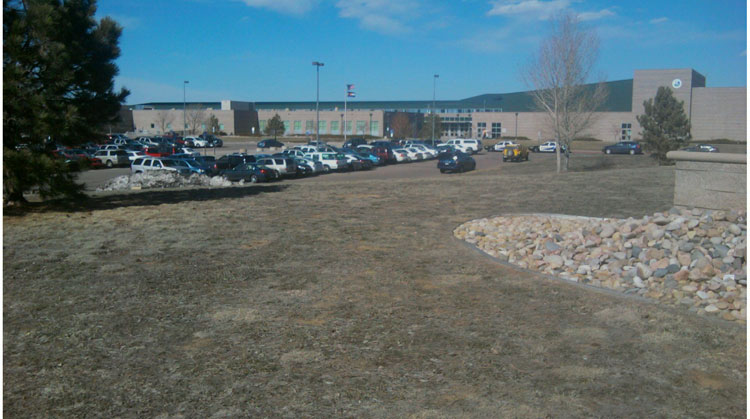 Douglas County Sheriff's Office patrol cars outside ThunderRidge High School, Highlands Ranch, Colo.