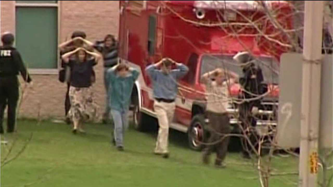 Students evacuated from Columbine H.S. after shootings. April 20, 1999