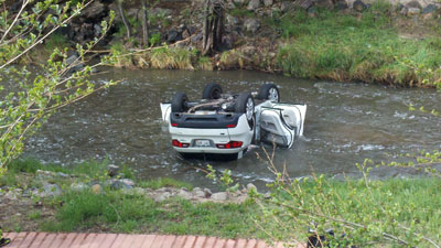 The accident scene at 8th & Speer Blvd. where the SUV crashed into Cherry Creek. April 15, 2012