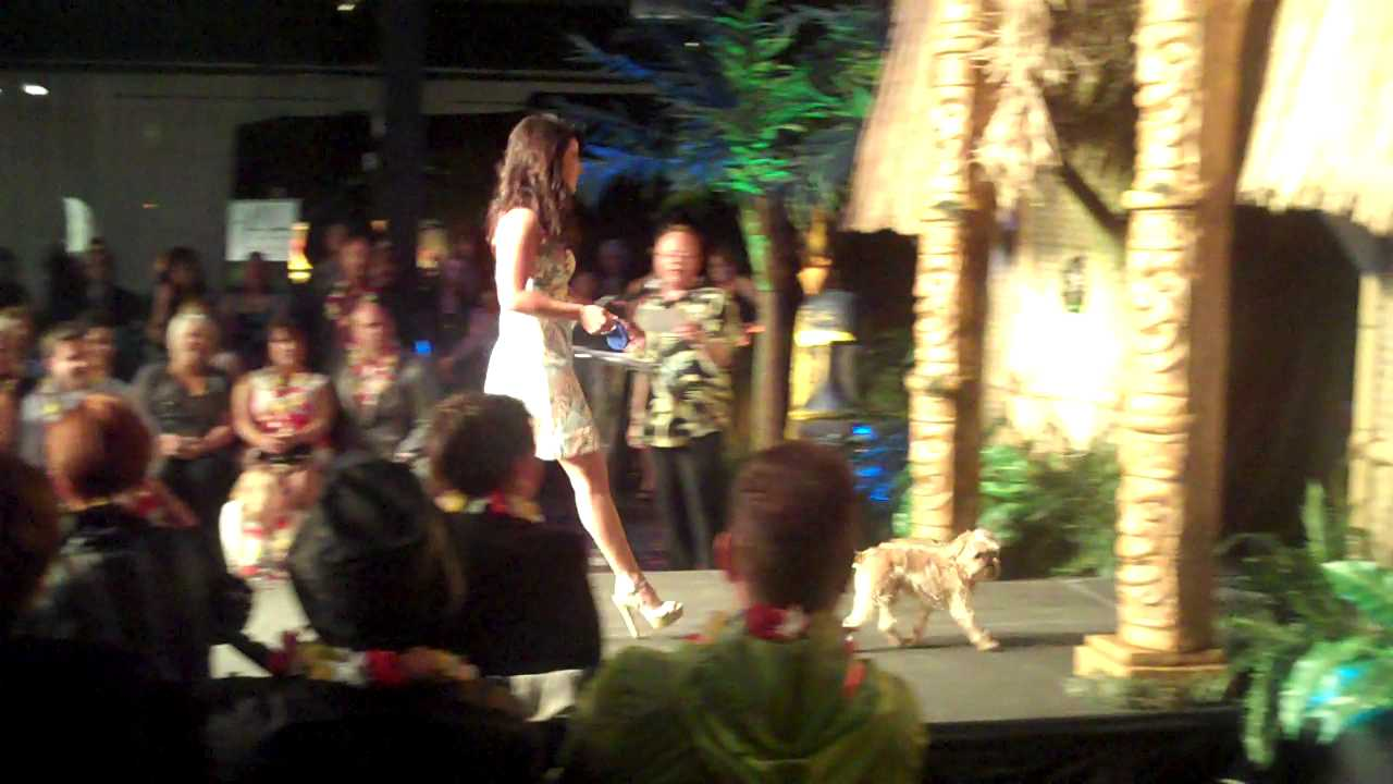 Good Day Colorado anchor Melody Mendez with her dog at Mutts and Models fundraiser