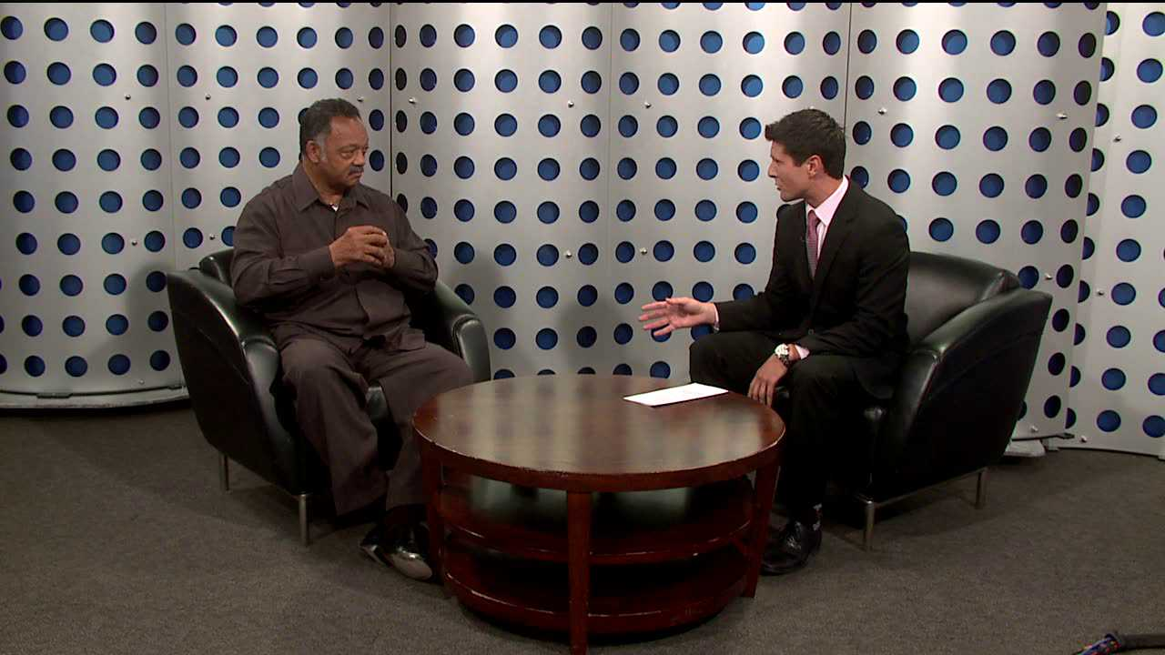 Rev. Jesse Jackson and Nick Emmons chat during Good Day Colorado. May 30, 2012