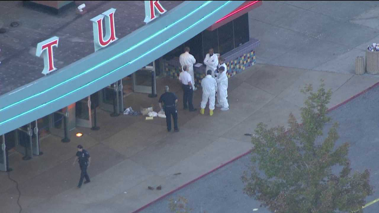 Police gather at the scene of a shooting at an Aurora theater, July 20, 2012.