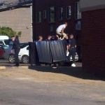 Aurora theater shooting, July 20, 2012 -- Police dig bullet casings out of the trash behind the suspect's apartment