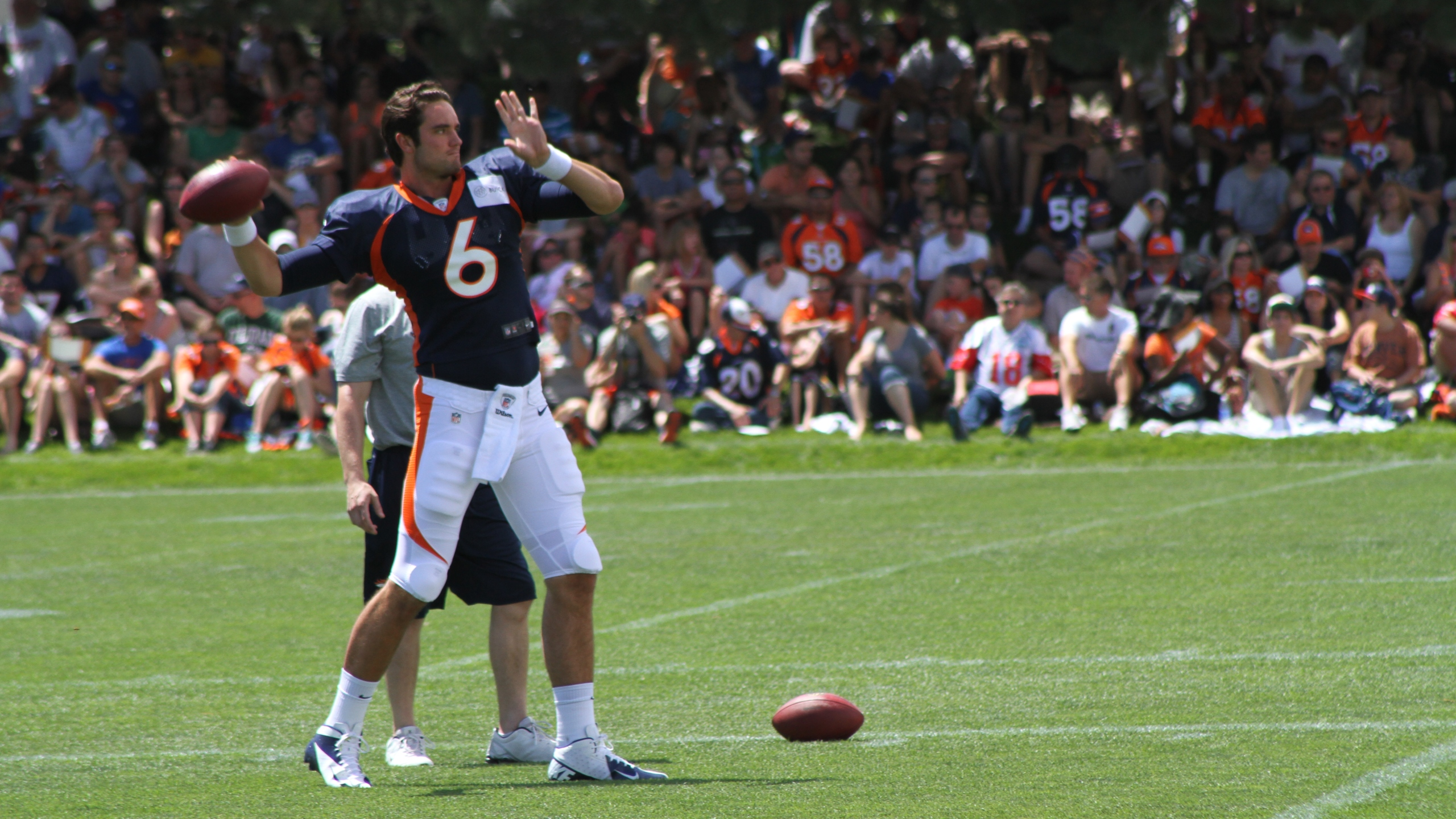 Brock Osweiler throws during Day 5 of camp, July 30, 2012.