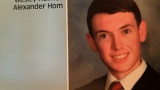 Suspect James Holmes, in a San Diego high school yearbook photo