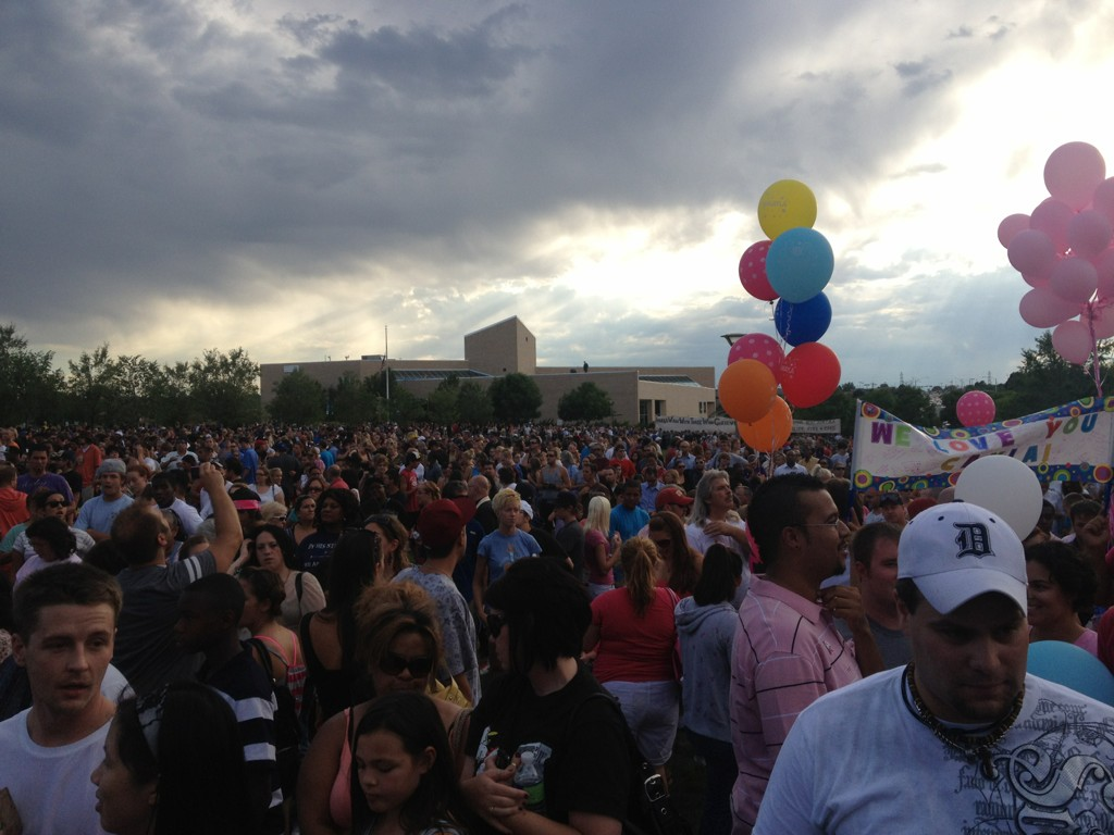 Crowds gather at the Aurora memorial vigil.
