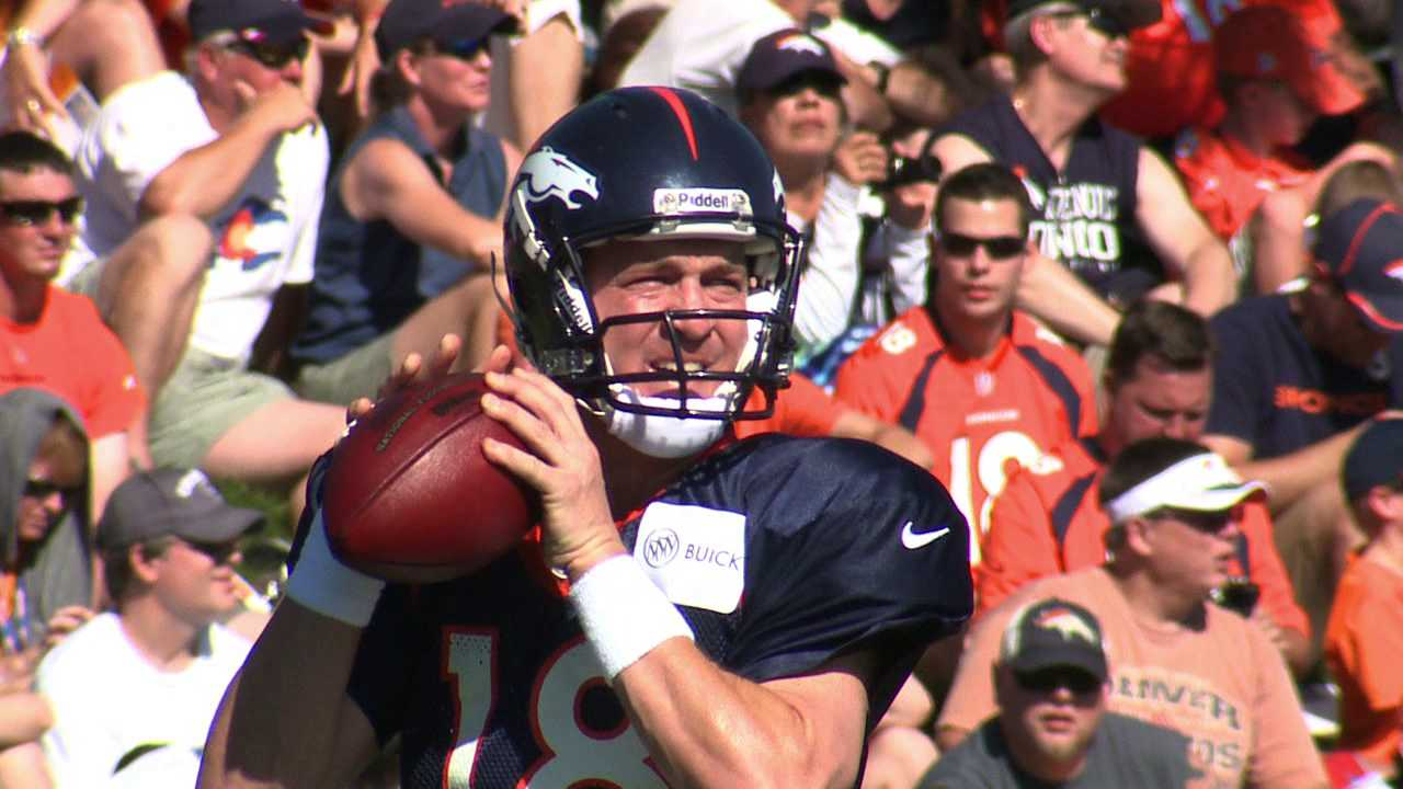 Large crowd watches Peyton Manning throw at Broncos training camp. July 30, 2012