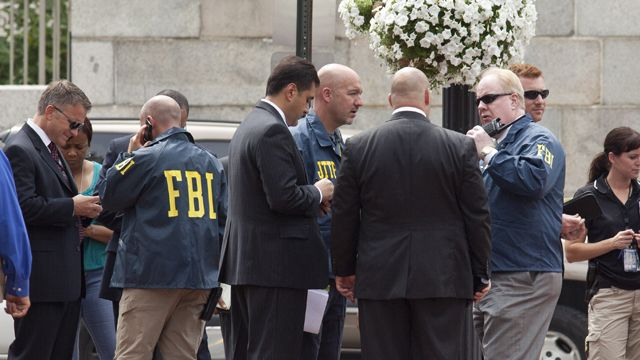 Investigators gather outside the Family Research Council in Washington D.C. after a gunman shot a security guard. Aug. 15, 2012. (Credit: FOX News)