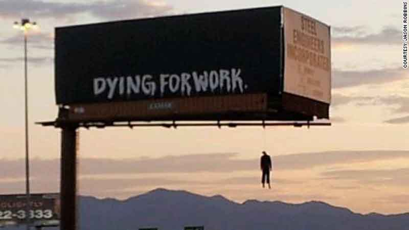 One of two billboards that featured dangling dummies seen in Las Vegas on Aug. 8, 2012.