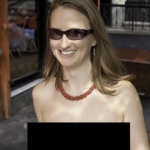 Moira Johnston was seen exercising her legal right to walk topless through New York City on Aug. 11, 2012.