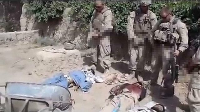 A pixilated still image from a video puporting to show U.S. Marines urinating on dead Taliban fighters (CNN)