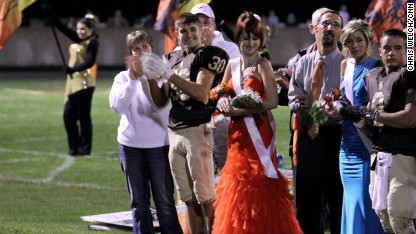 Whitney Kropp, the teen thrust into the spotlight after her peers nominated her for homecoming court as a prank, attended coronation surrounded by cheering fans (CNN)
