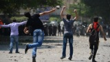 Egyptian protesters clash with riot police Thursday near the U.S. Embassy in Cairo
