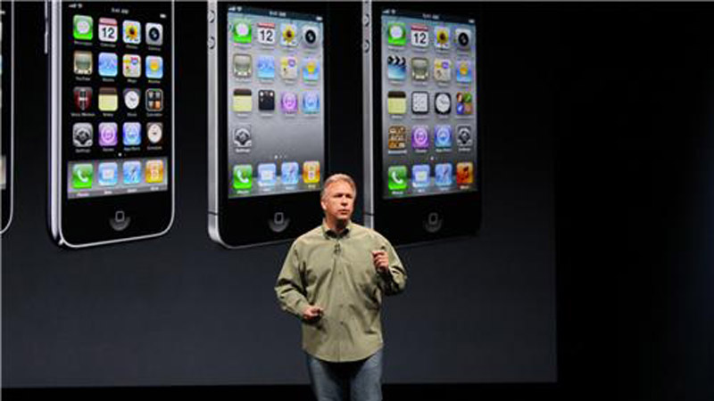 Apple marketing chief Phil Schiller with a slide showing versions of the iPhone. The new, slightly taller iPhone 5 is at right. (Photo: CNN)