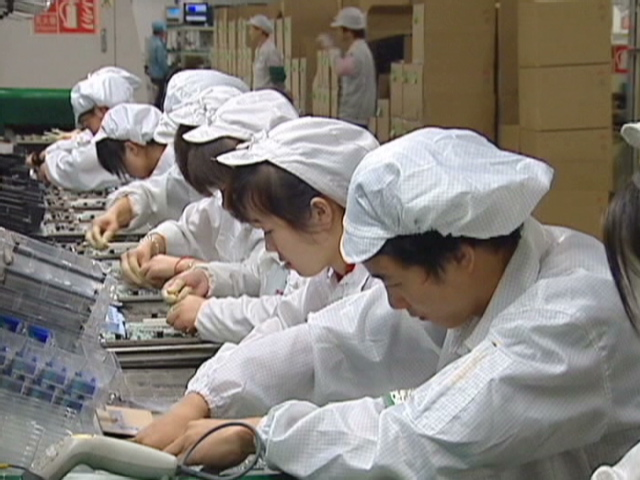 Foxconn student interns work on iPhone 5 assembly lines in China.