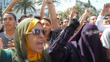 Moroccan women gather near the U.S. Embassy in Casablanca on Wednesday