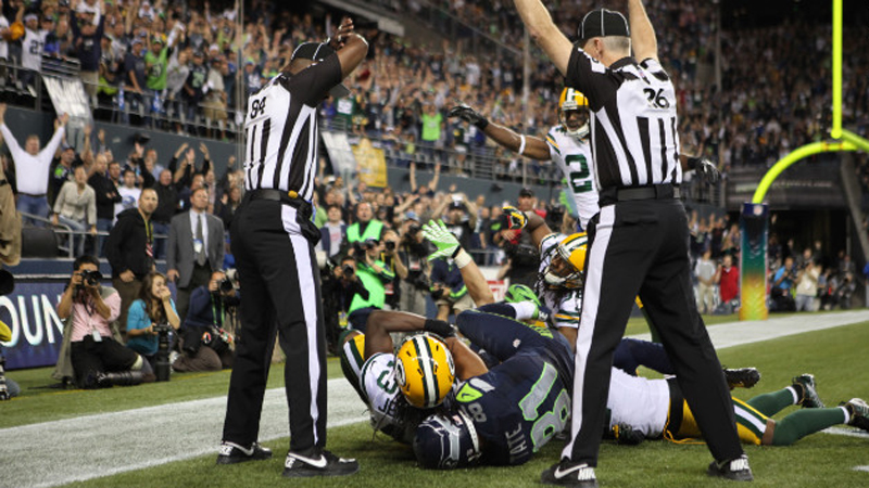NFL replacement referees struggle to whether or not to give Seattle Seahawks wide receiver Golden Tate a touchdown on Sept. 24, 2012. Tate was awarded a touchdown despite the fact that it appeared M.D. Jennings had intercepted the pass. (CNN)