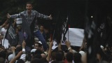 People shout in front of the U.S. Embassy in Cairo
