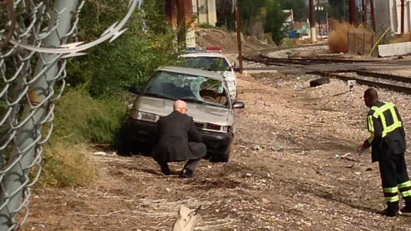 A witness photo obtained by FOX31 shows police investigating an abandoned car on Sept. 26, 2012. The car matches the description of a vehicle involved in a fatal hit-and-run on Sept. 23, 2012.
