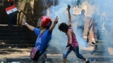 Police use tear gas on crowds protesting Thursday outside the U.S. Embassy in Cairo