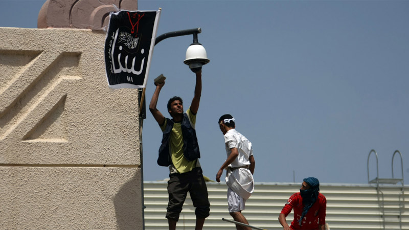 Yemeni protesters try to break the security camera at the U.S. Embassy in Sanaa on Thursday