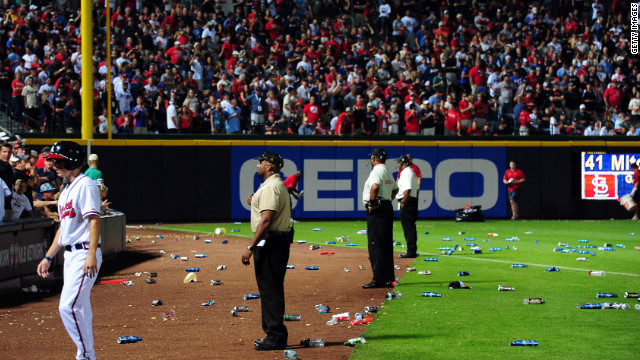Bottles and cups thrown by unhappy fans litter the field after the controversial call (Getty Images)