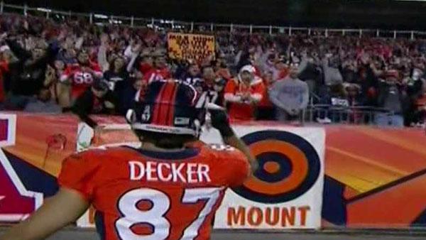 Eric Decker salutes Sports Authority Field fans after catching a touchdown pass from Peyton Manning on Oct. 28, 2012.