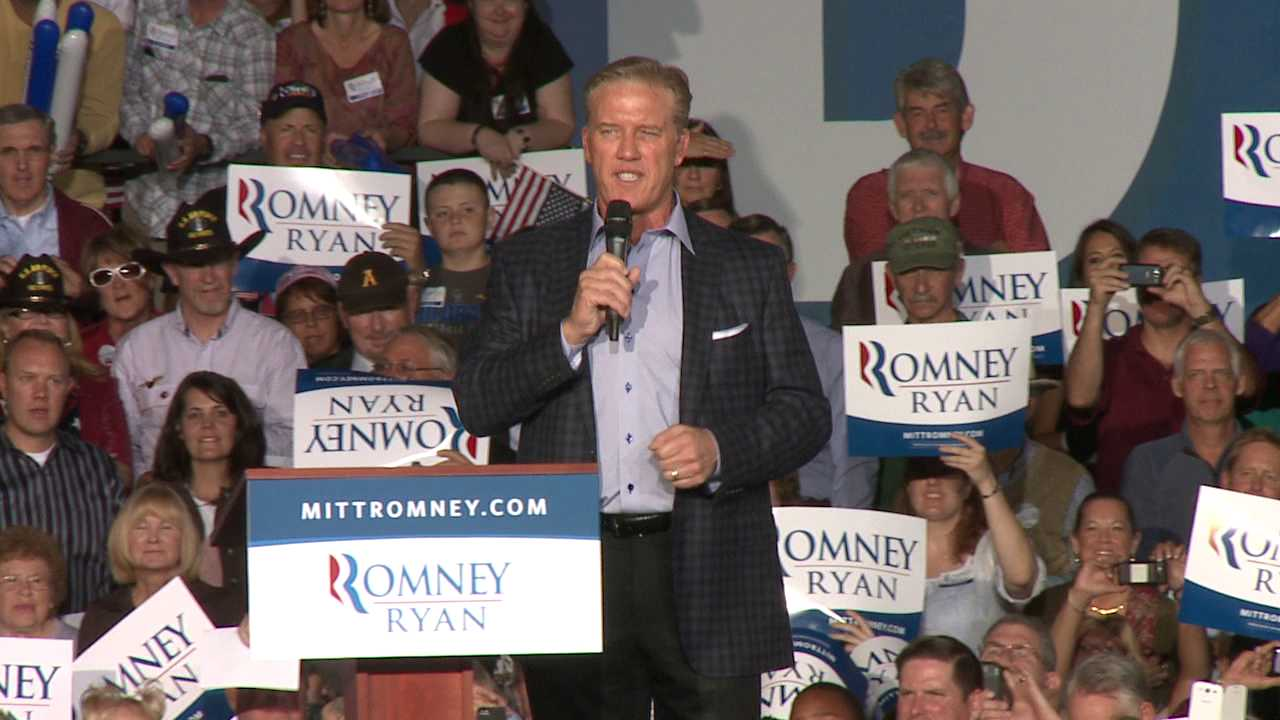 John Elway introduces Mitt Romney during a rally for the GOP candidate at the Wings of the Rockies Air and Space Museum in Lowry on Oct. 1, 2012.