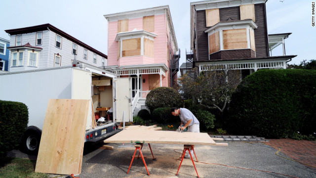 Burt Myrich boards up a home in preparation for Hurricane Sandy on Saturday, October 27, in Cape May, New Jersey (CNN)