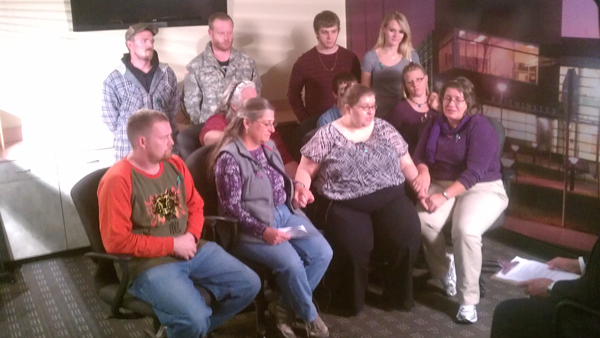 Jessica Ridgeway's father, Jeremy Bryant (far left, front row), is joined by the 10-year-old's mother, Sarah Ridgeway (second from right, front) and members of their extended family on Oct. 9, 2012 at the Westminster Police Department. The family was making their first public statement since Jessica went missing on Oct. 5, 2012.