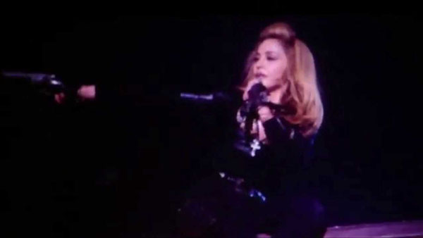 Madonna points a fake gun at a Denver audience after showing up almost three hours late to a concert at the Pepsi Center on Oct. 19, 2012.