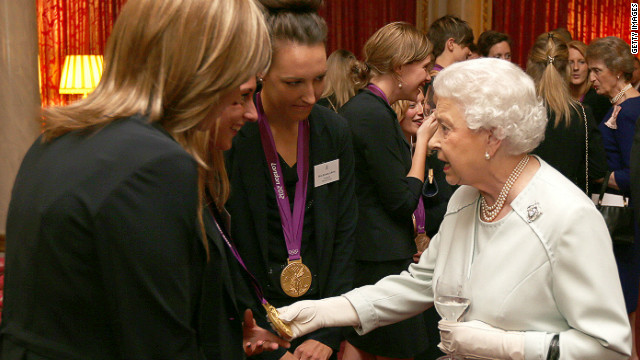 The Queen meets British Olympians at a reception hours before two athletes had their medals stolen from a nightclub (CNN).