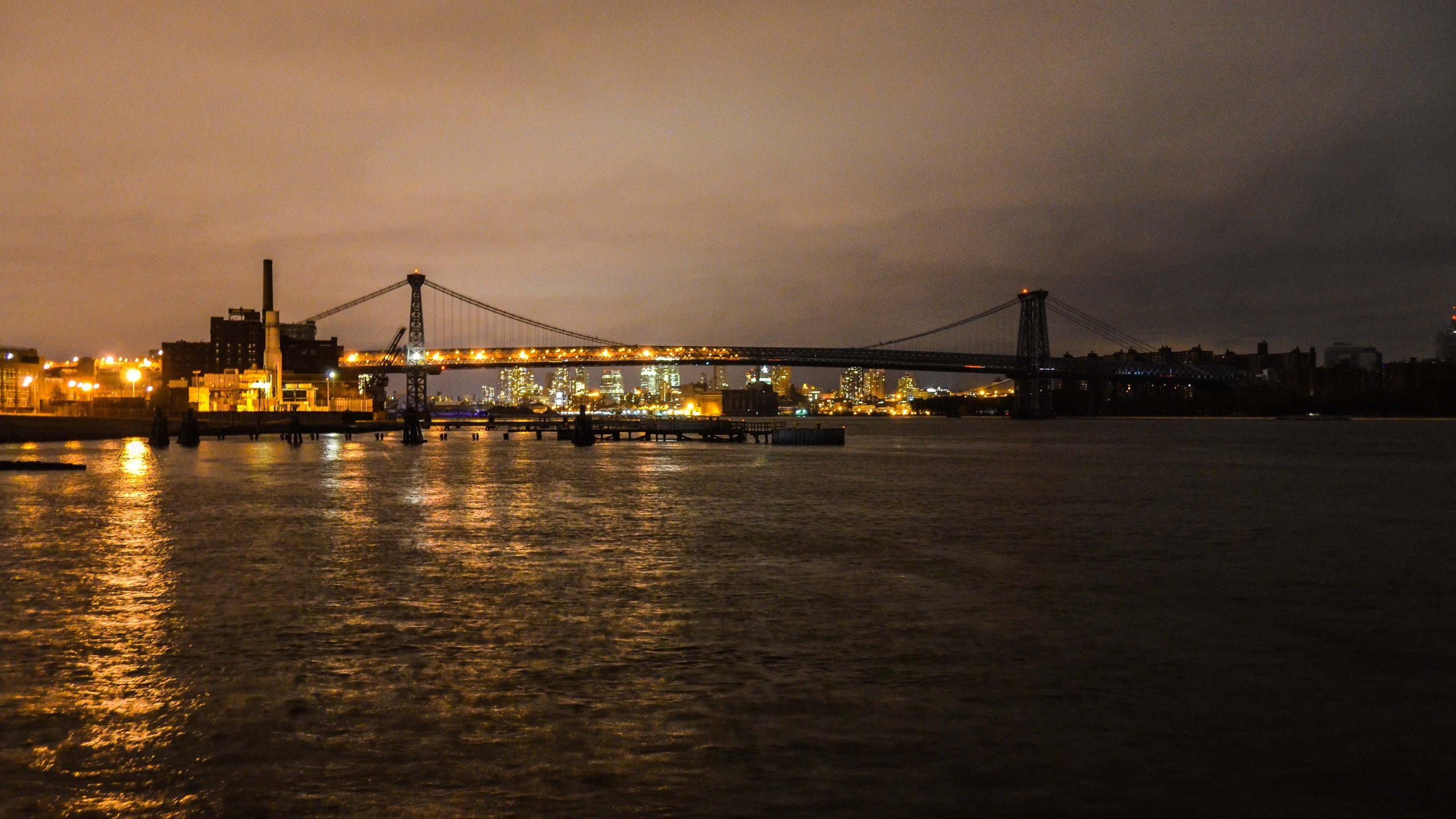 As of Oct. 30, 2012, half of the Williamsburg Bridge in Brooklyn was lit, half of it was not. Much of New York City was still without power when the New York Marathon was called off on Nov. 1, 2012. (Photo: Verge.com)
