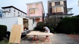 Burt Myrich boards up a home in preparation for Hurricane Sandy on Saturday, October 27, in Cape May, New Jersey (CNN).