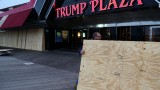 Scott Davenport brings plywood to cover the windows at the Trump Plaza casino on the boardwalk in Atlantic City, New Jersey, on Sunday