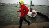 Corey Hutterli works on securing his sailboat as the outer bands of Hurricane Sandy are felt in Miami Beach, Florida, on Thursday, October 25 (CNN).