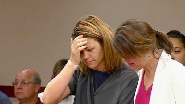 Castle Rock's Kelli Murphy, left, appears in court. Her trial began on Nov. 14, 2012, and she was found guilty of first degree murder on Nov. 27, 2012.