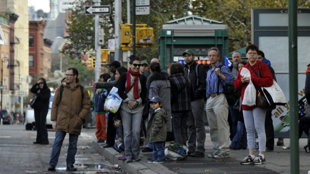 New Yorkers wait for buses on Sixth Avenue on Oct. 31, 2012. in the aftermath of Superstorm Sandy. (CNN)