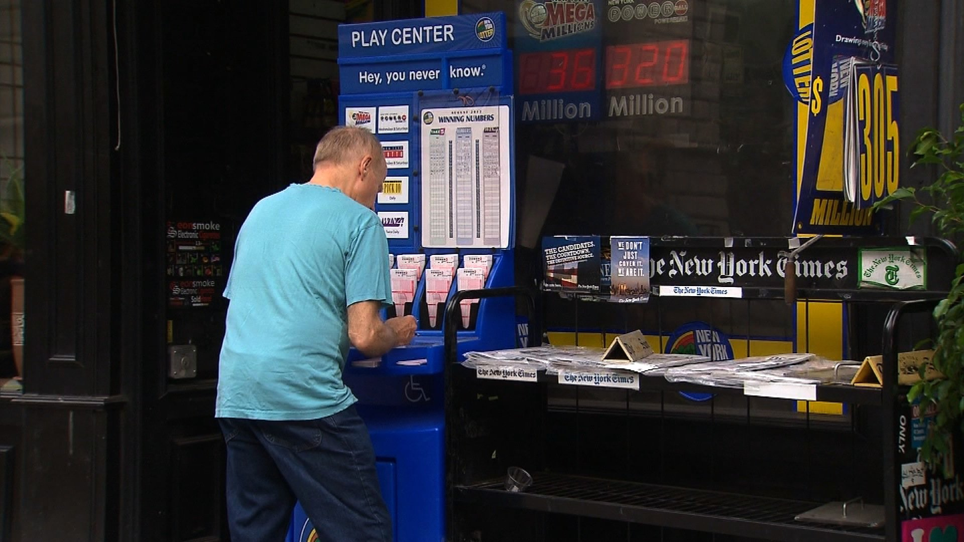 Man in New York fill our Powerball Lottery tickets on Wednesday, August 15, 2012.