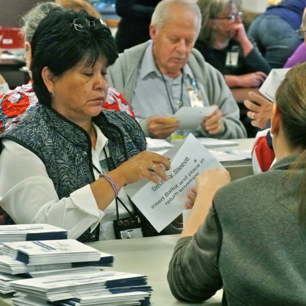 Election workers processing mail-in ballots in Boulder County, Colorado on Tuesday, November 6, 2012. Ballots are sorted by precinct and every single signature is scanned and matched up to voter registration signatures by hand.
