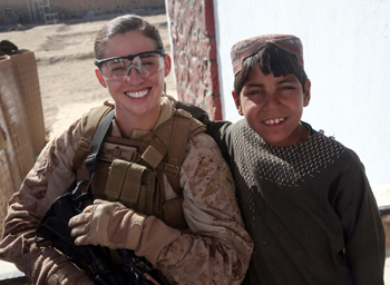 Colleen Farrell with a young boy during a medical outreach mission in Afghanistan's Helmand Province. (Photo: Haverford.com)