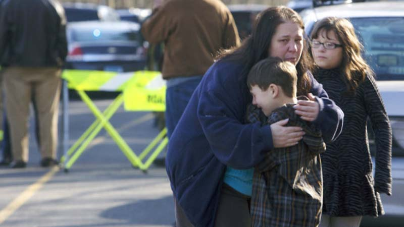 A young boy is comforted outside Sandy Hook Elementary School on Dec. 14, 2012 (Photo: CNN)