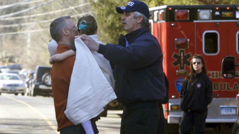 A young girl is given a blanket after being evacuated from Sandy Hook Elementary School on Dec. 14, 2012. (Photo: CNN)