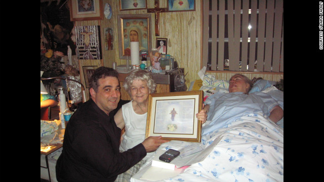 """At Edwarda's birthday party in 2006, Manny Koukoulas presents Kathryn and Edwarda with a song, """"My Blessed Child,"""" that he wrote for them. (CNN)"""