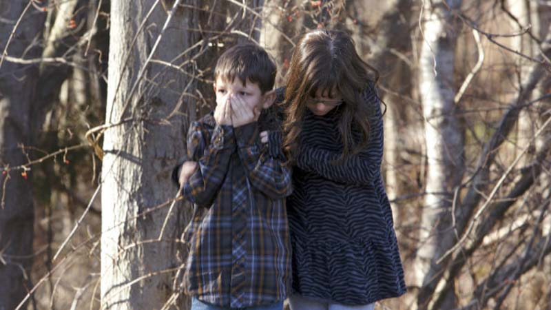 Children wait outside Sandy Hook Elementary School in Newtown, Conn., after a fatal shooting on Dec. 14, 2012. (Photo: CNN)