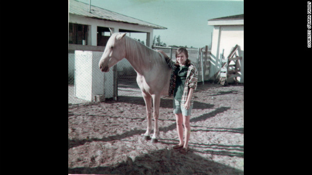 """Edwarda with her horse Moonlight in 1967; at a nearby ranch, the sisters' friendship grew. """"Colleen had horses, and Edwarda had a pony because she was always the cautious one,"""" their cousin Pam Burdgick said. (CNN)"""