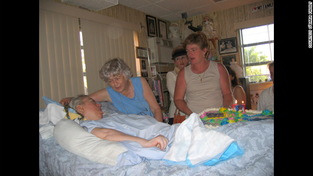 Family and friends gather for Edwarda's birthday in 2004. (CNN)