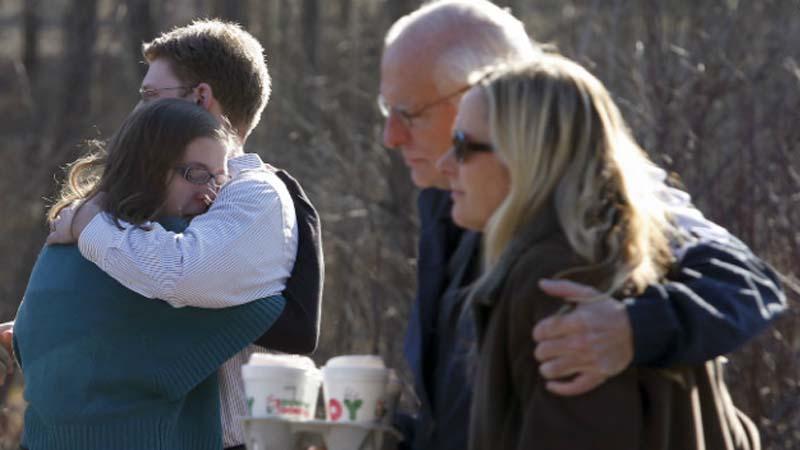 Family members embrace each other outside of Sandy Hook Elementary School on Dec. 14, 2012 (Photo: CNN)